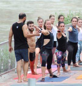 Mantra Yoga Meditation Students Practicing Yoga nearby Ganges